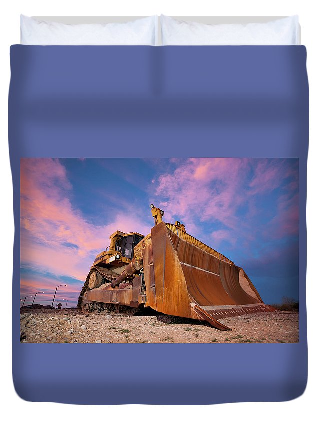 Toughness Duvet Cover featuring the photograph Yellow Bulldozer Working At Sunset by Wesvandinter