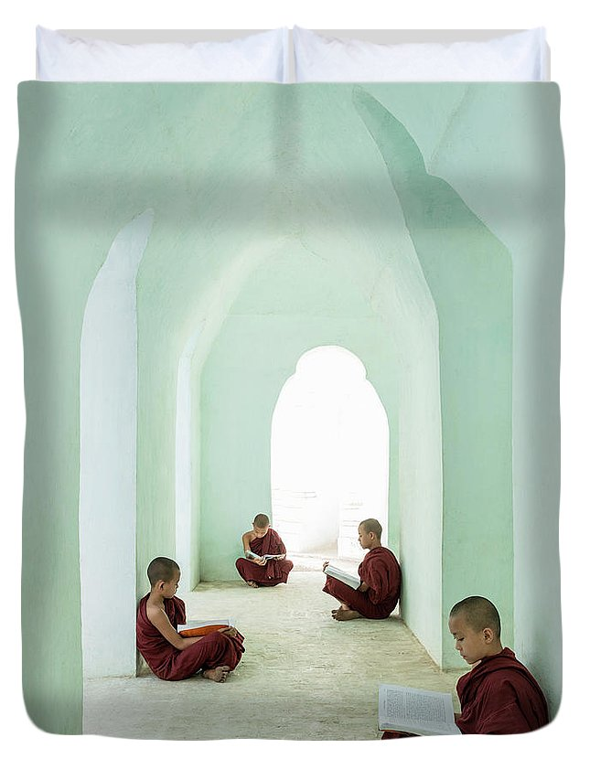Arch Duvet Cover featuring the photograph Young Buddhist Monks Reading In Temple by Martin Puddy