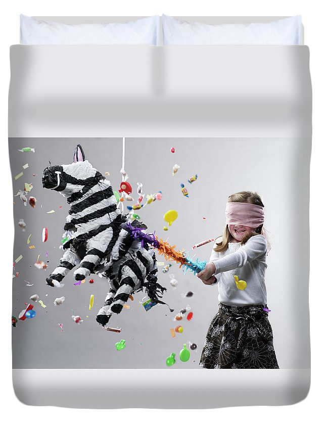 4-5 Years Duvet Cover featuring the photograph Young Girl Hitting Pinata, Candy Flying by Ryan Mcvay