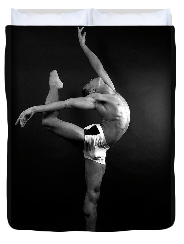 Human Arm Duvet Cover featuring the photograph Young Male In Dancer Pose by Michael Rowe