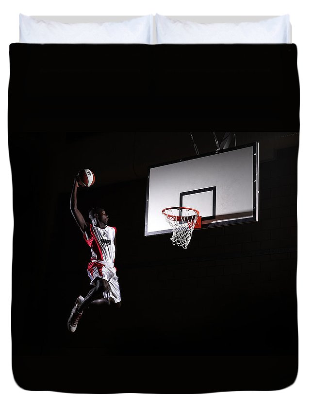 Human Arm Duvet Cover featuring the photograph Young Man In The Air About To Dunk The by Compassionate Eye Foundation/steve Coleman/ojo Images Ltd