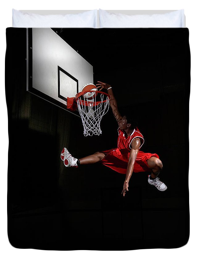 Human Arm Duvet Cover featuring the photograph Young Man Making A Fancy Dunk by Compassionate Eye Foundation/steve Coleman/ojo Images Ltd