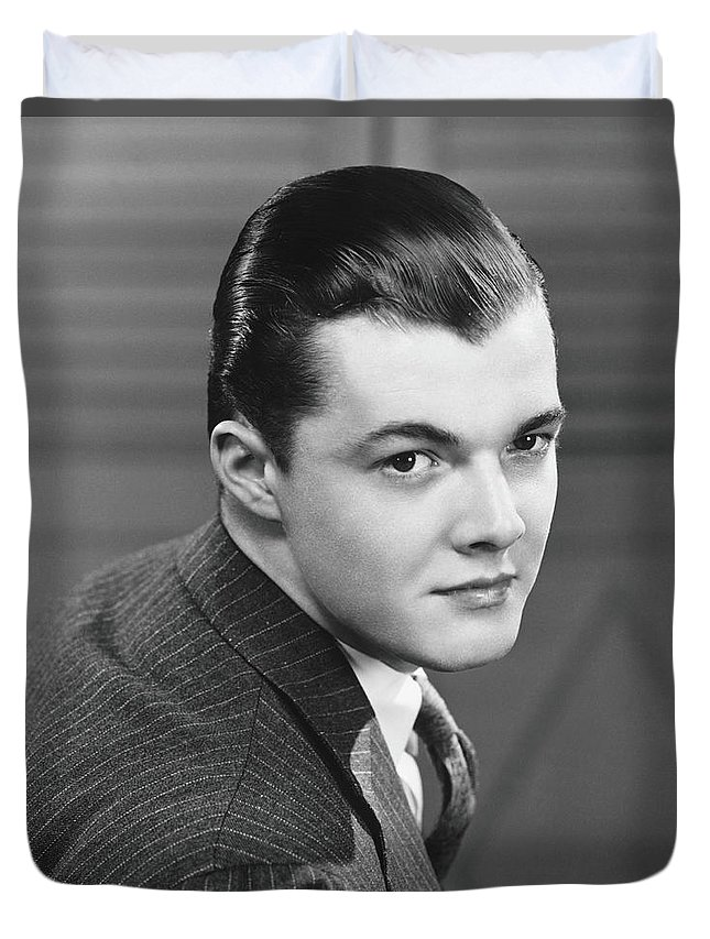 Young Men Duvet Cover featuring the photograph Young Man Wearing Pinstripe Jacket by George Marks