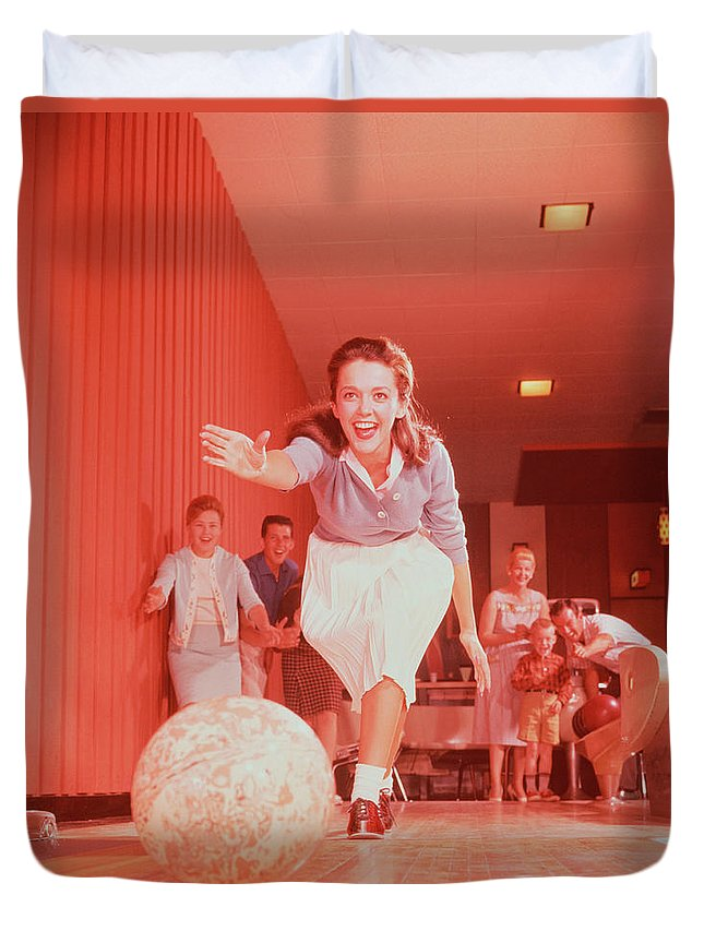People Duvet Cover featuring the photograph Young Woman Bowling, Family Watching In by Fpg