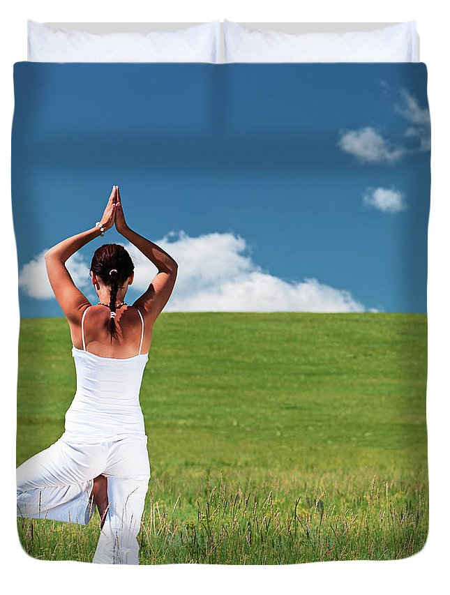 Scenics Duvet Cover featuring the photograph Young Woman Practicing Yoga by Hadynyah