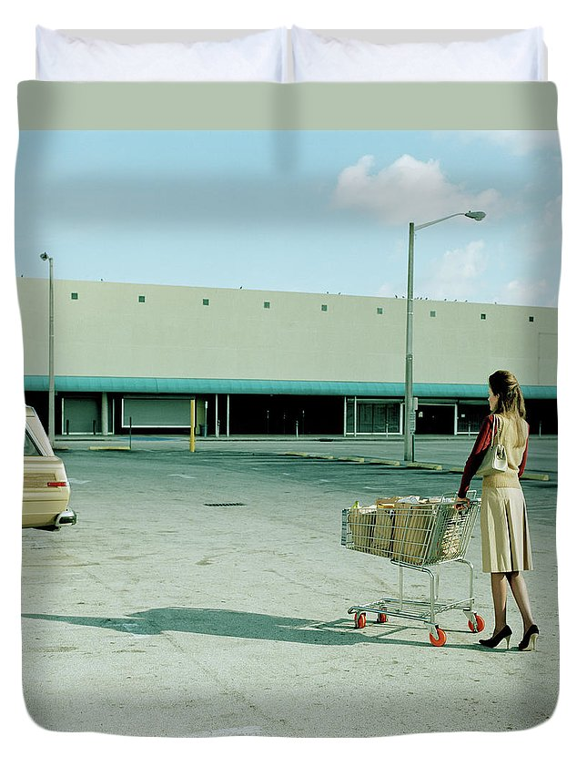Casual Clothing Duvet Cover featuring the photograph Young Woman Pushing Trolly Full Of by Kelvin Murray
