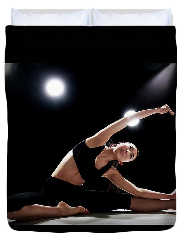 People Duvet Cover featuring the photograph Young Woman Stretching by Runphoto