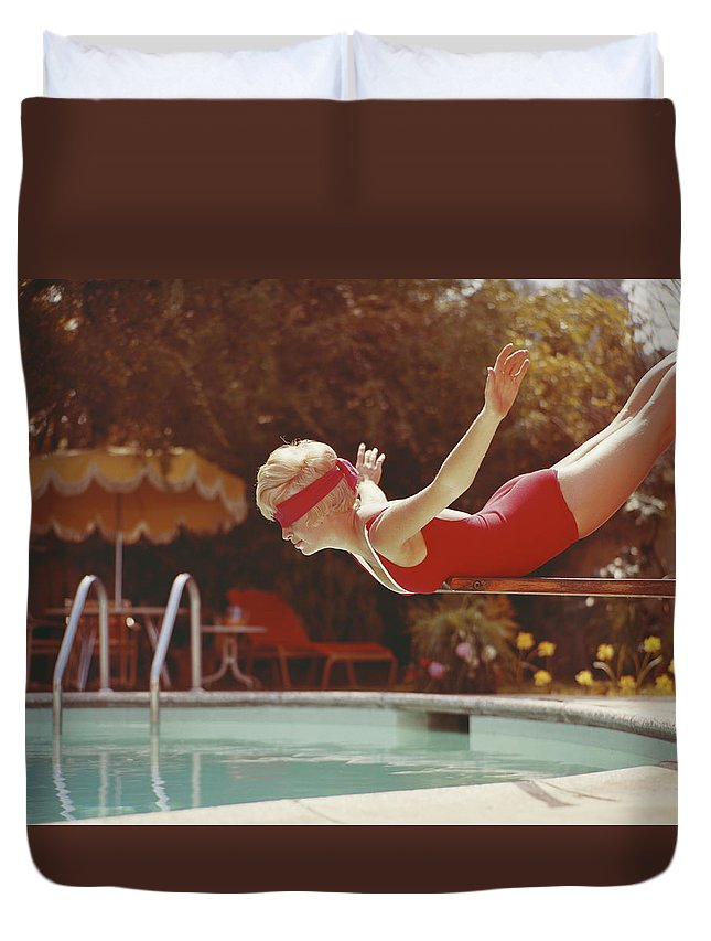 Human Arm Duvet Cover featuring the photograph Young Woman With Blindfold Balancing On by Tom Kelley Archive