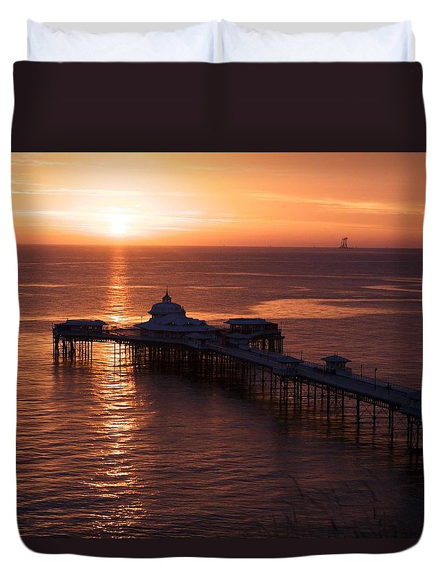 Piers Duvet Cover featuring the photograph Sunrise over Llandudno pier 2 by Christopher Rowlands