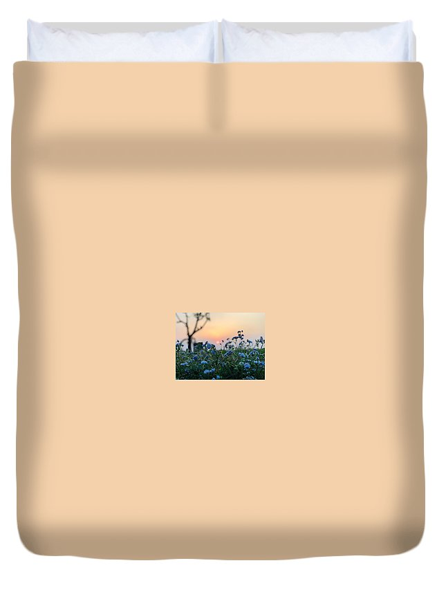 Flowers Duvet Cover featuring the photograph Sunset Behind Flowers by Prashant Dalal