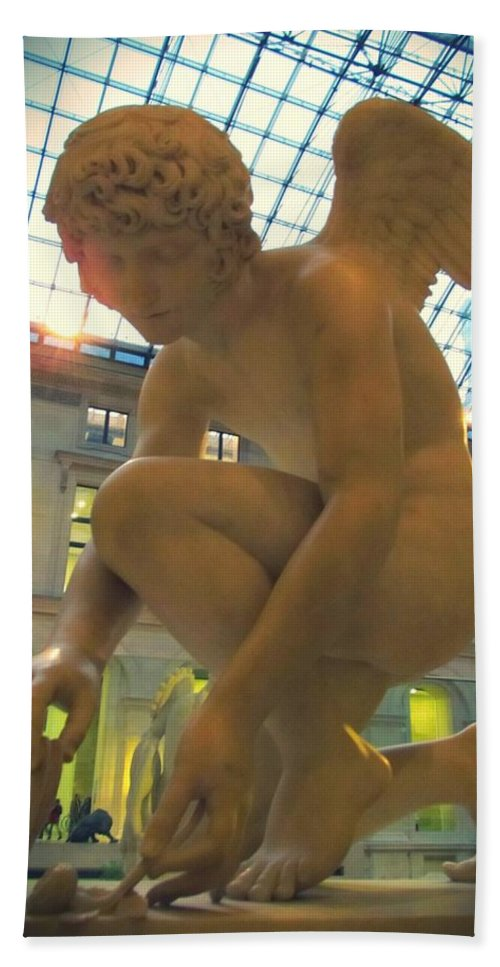 Cupid Playing With A Butterfly Bath Towel featuring the photograph Cupid Playing With A Butterfly - Louvre Museum Paris by Marianna Mills