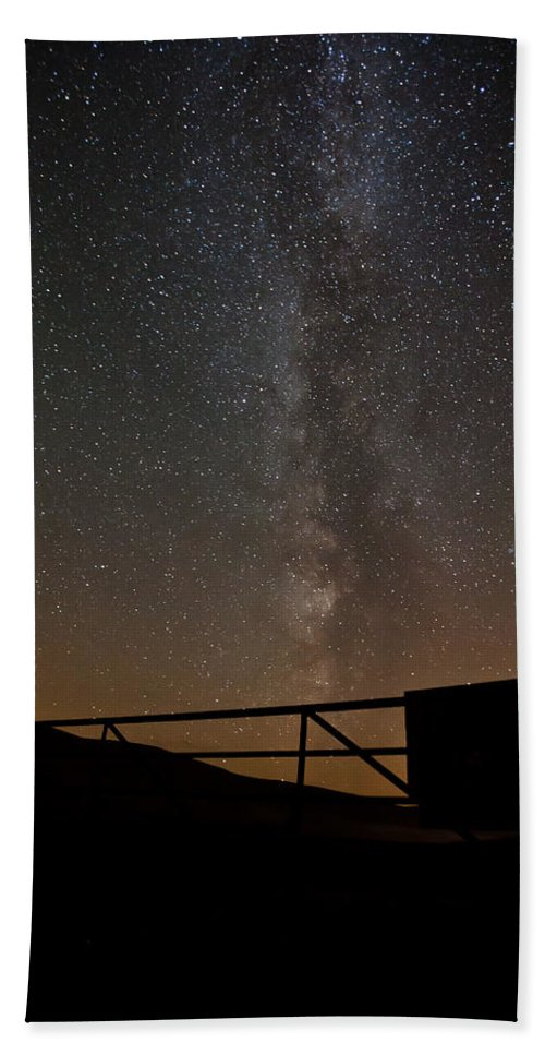 Astrophotography Bath Sheet featuring the photograph Milky Way Behind The Gate by Beverly Cash