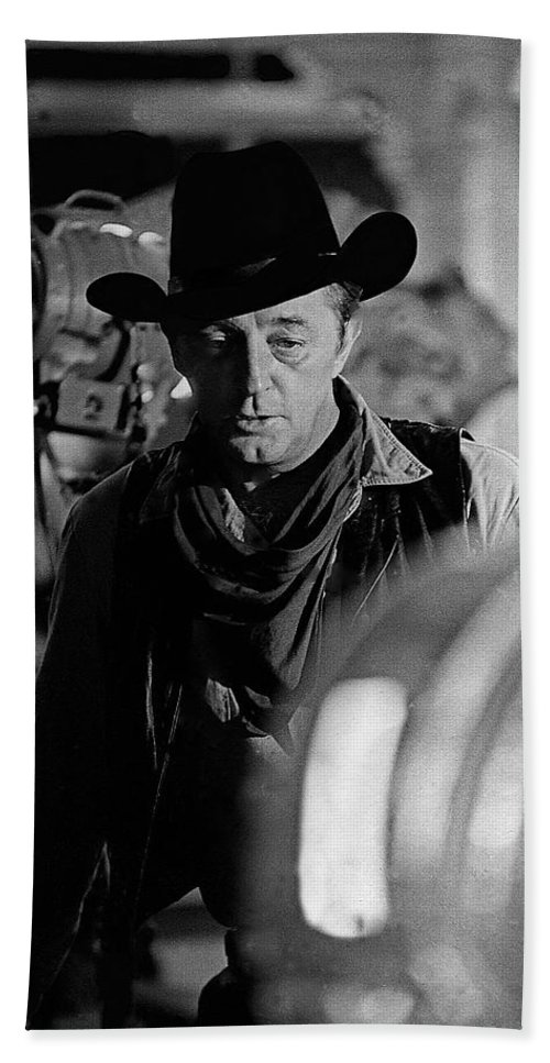 Robert Mitchum Lights Young Billy Young Set Old Tucson Sound Stage Black And White Hand Towel featuring the photograph Robert Mitchum Lights Young Billy Young Set Old Tucson by David Lee Guss