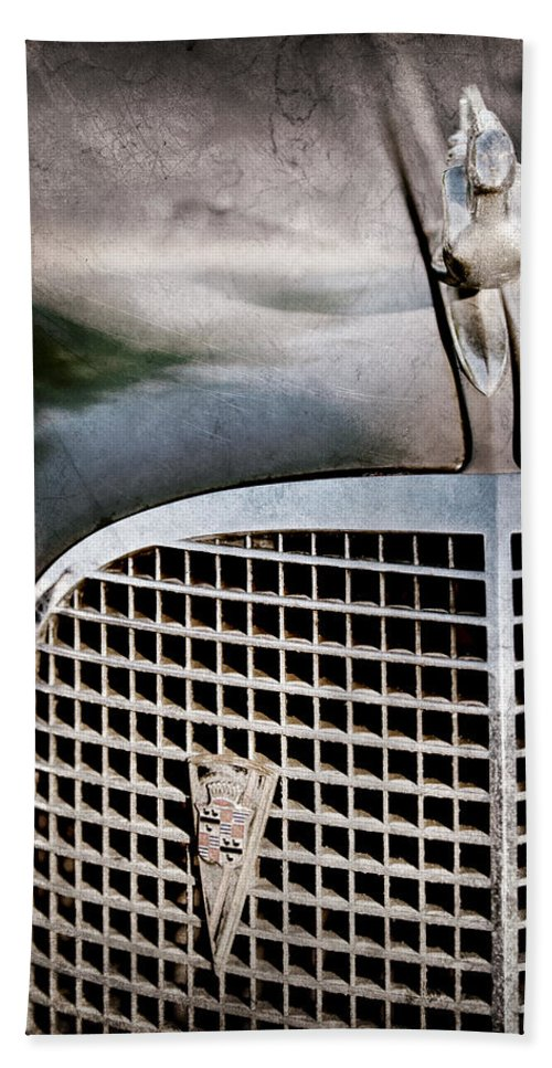 1937 Cadillac Hood Ornament And Grille Emblem Hand Towel featuring the photograph 1937 Cadillac Hood Ornament And Grille Emblem by Jill Reger