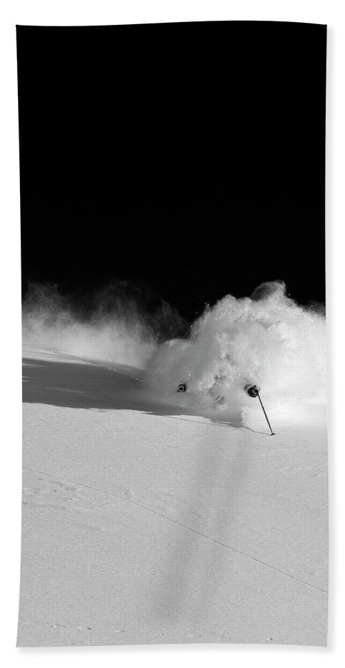 Action Hand Towel featuring the photograph A Male Skier Skis Through Deep Powder by Mark Fisher