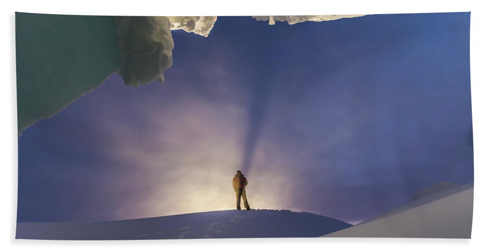 40-44 Years Hand Towel featuring the photograph A Man Stands At The Entrance Of An Ice by Alasdair Turner
