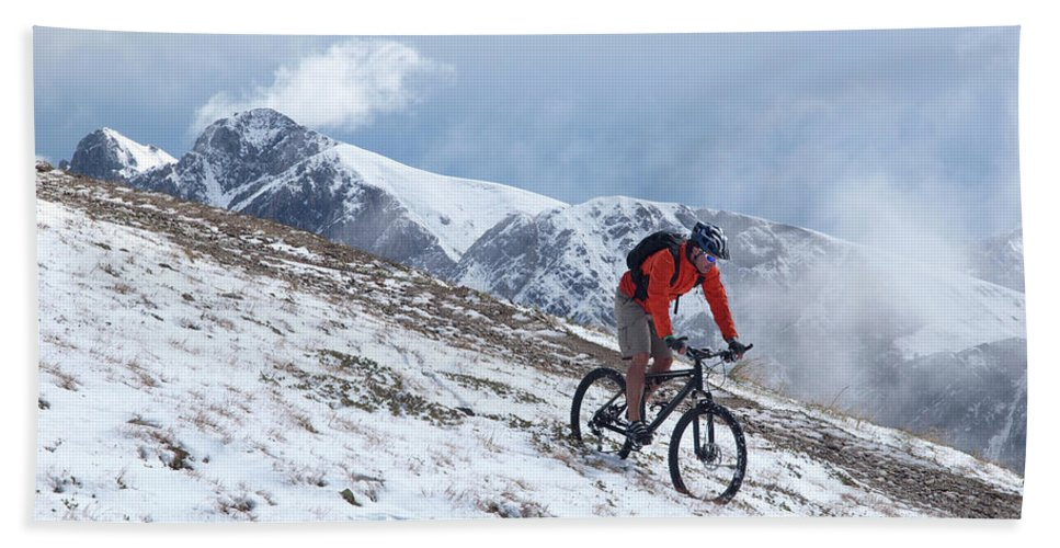 35-39 Years Hand Towel featuring the photograph A Mountain Biker Rides Through The Snow by Menno Boermans