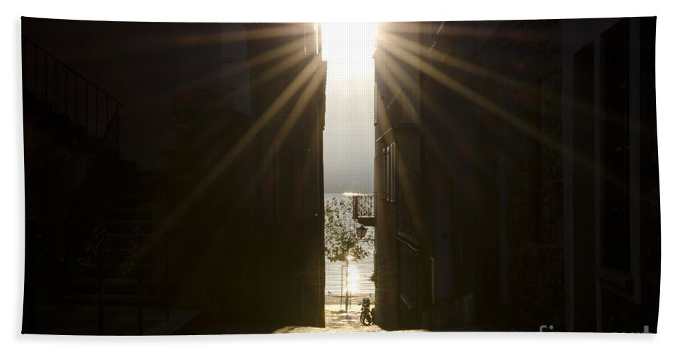 Alley Hand Towel featuring the photograph Alley With Sunbeam by Mats Silvan