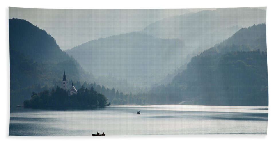 Bled Hand Towel featuring the photograph Breaking Through The Mist by Ian Middleton