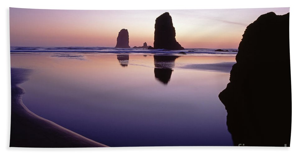 Pacific Northwest Hand Towel featuring the photograph Needles Silhouetted Cannon Beach Oregon by Jim Corwin