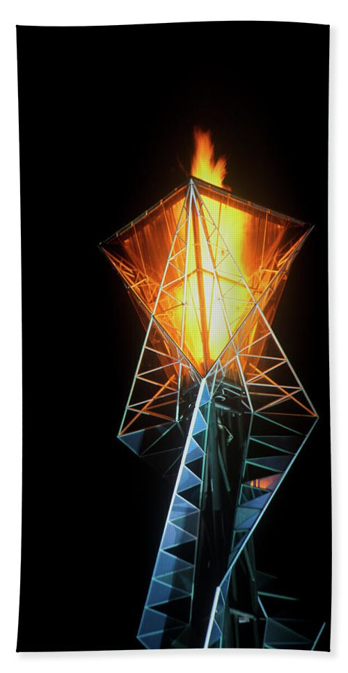 Photography Bath Towel featuring the photograph Olympic Torch At Night During The 2002 by Panoramic Images