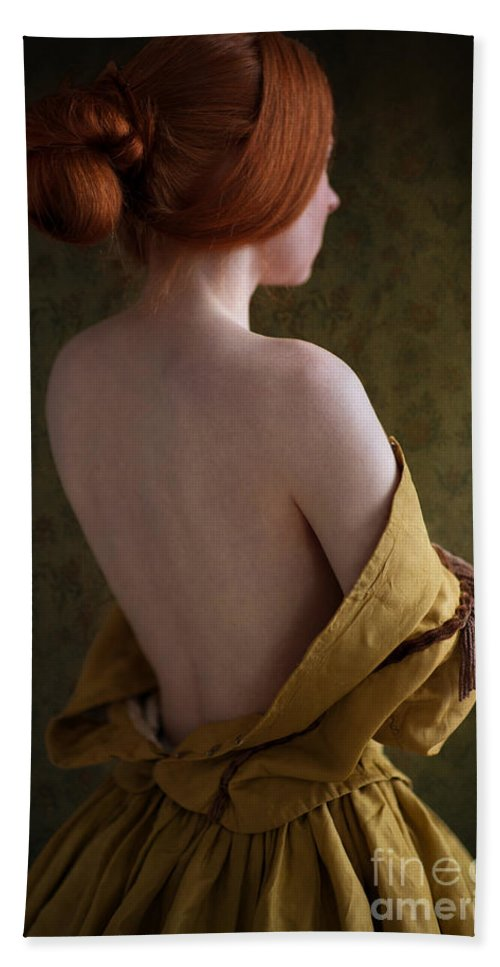 Victorian Hand Towel featuring the photograph Redhead Woman Removing A Ballgown by Lee Avison