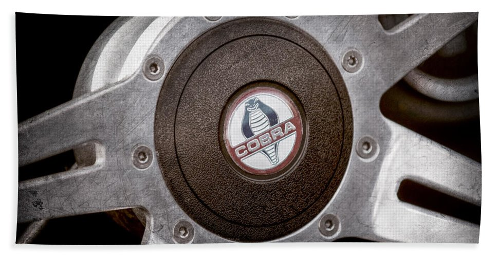 Shelby Cobra Steering Wheel Emblem Hand Towel featuring the photograph Shelby Cobra Steering Wheel Emblem by Jill Reger