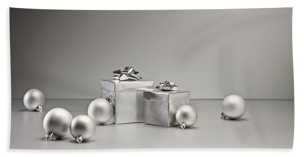 New Hand Towel featuring the photograph Silver Bauble And Present by U Schade