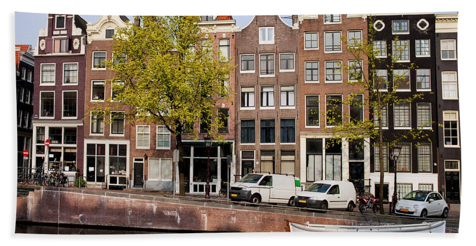Amsterdam Hand Towel featuring the photograph Singel Canal Houses In Amsterdam by Artur Bogacki