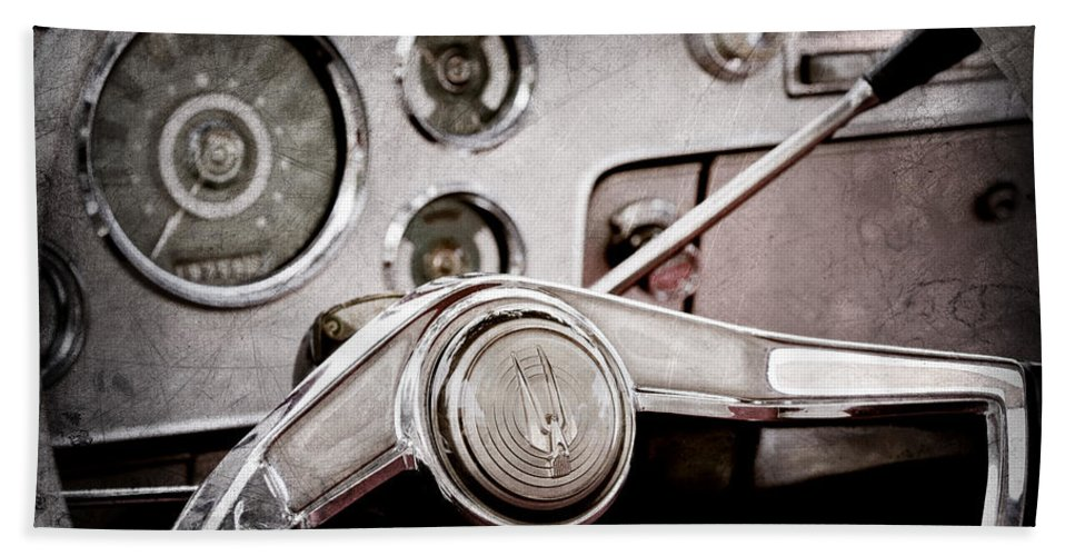 Studebaker Steering Wheel Emblem Bath Sheet featuring the photograph Studebaker Steering Wheel Emblem by Jill Reger