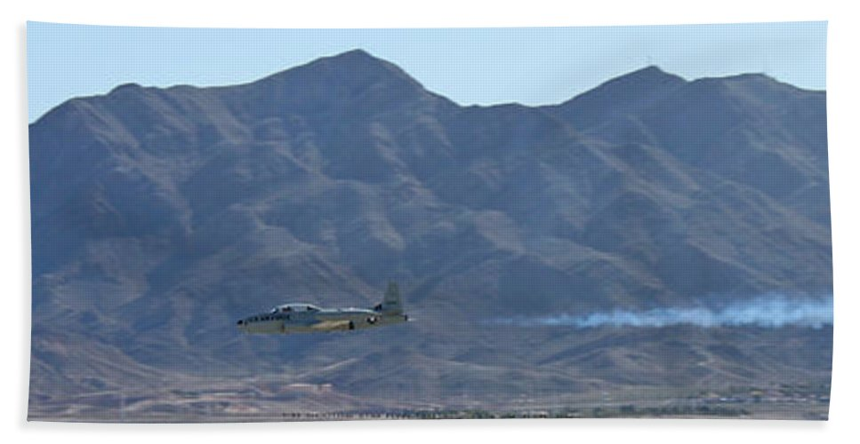 T33 Hand Towel featuring the photograph T-33 Shooting Star Flyby Nellis by Carl Deaville