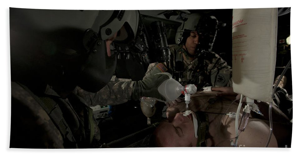 Army Bath Sheet featuring the photograph U.s. Army Medics Simulating Ventilation by Terry Moore