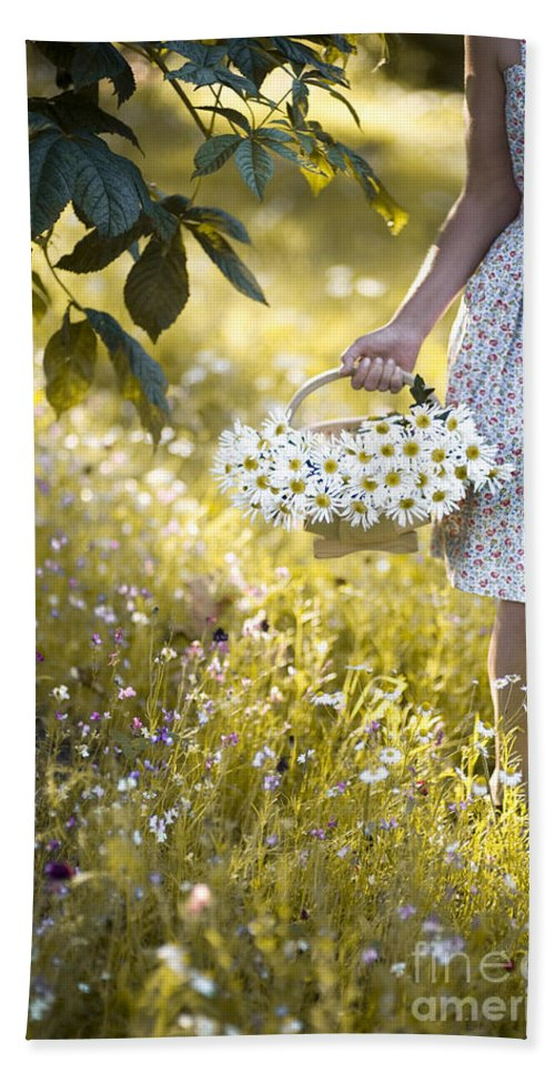 Woman Hand Towel featuring the photograph Woman Picking Flowers In A Wild Flower Meadow by Lee Avison