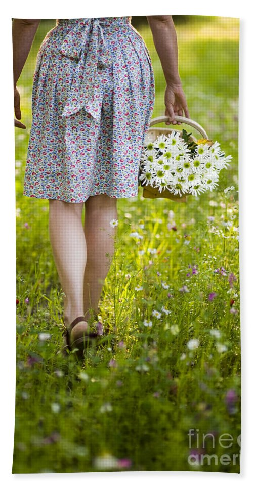 Woman Hand Towel featuring the photograph Woman Walking Through A Wild Flower Meadow With A Basket Of Flow by Lee Avison