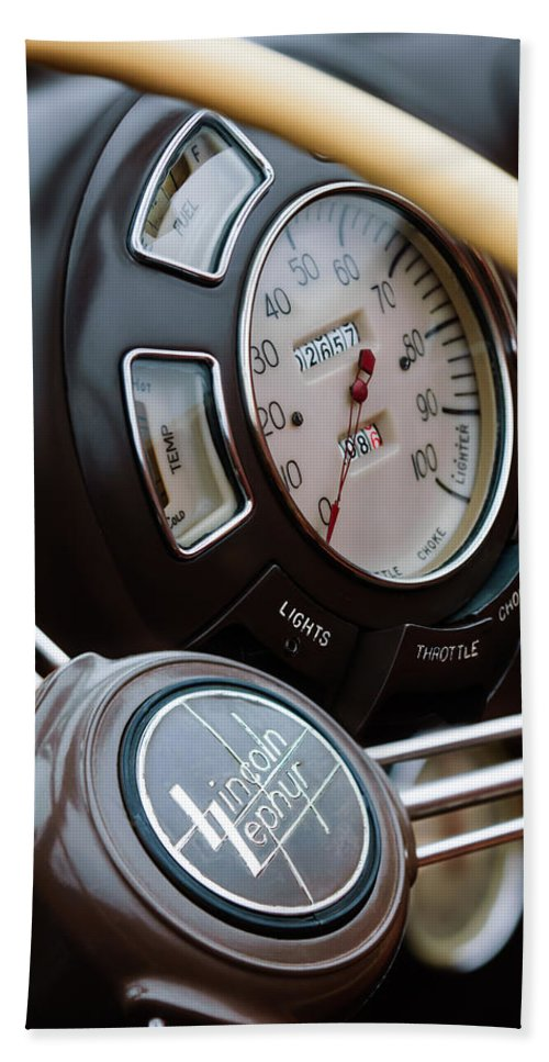 1938 Lincoln-zephyr Continental Cabriolet Steering Wheel Emblem Hand Towel featuring the photograph 1938 Lincoln-zephyr Continental Cabriolet Steering Wheel Emblem -1817c by Jill Reger
