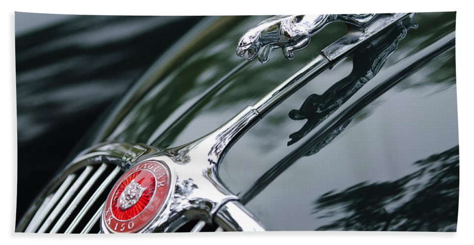Jaguar Xk 150 Hand Towel featuring the photograph Jaguar Xk 150 Hood Ornament by Jill Reger