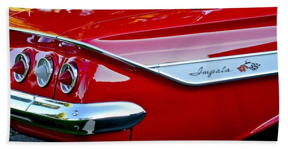 1961 Chevrolet Impala Bath Sheet featuring the photograph 1961 Chevrolet Impala Taillight Emblem by Jill Reger