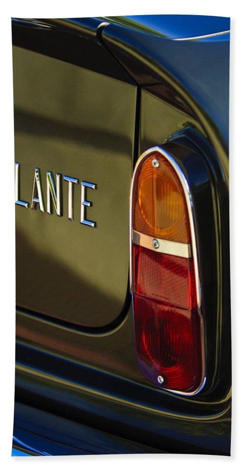 1967 Aston Martin Db6 Volante Hand Towel featuring the photograph 1967 Aston Martin Db6 Volante Tail Light by Jill Reger