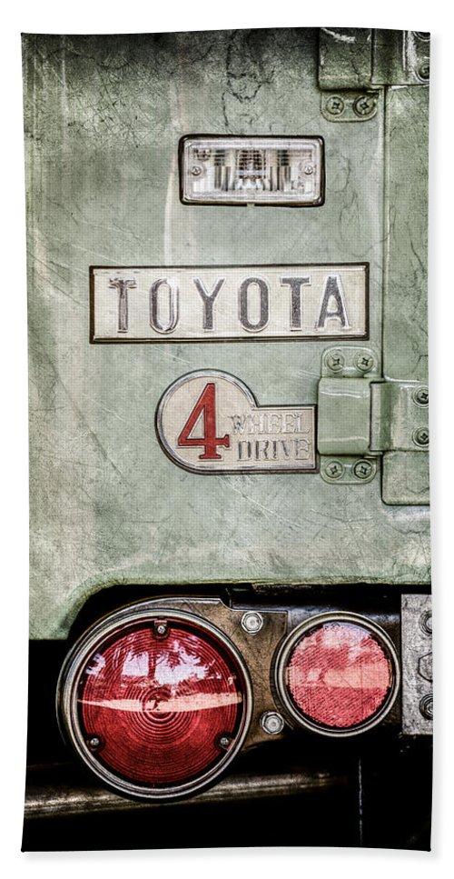 1969 Toyota Fj-40 Land Cruiser Taillight Emblem Bath Towel featuring the photograph 1969 Toyota Fj-40 Land Cruiser Taillight Emblem -0417ac by Jill Reger