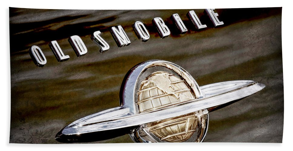 1950 Oldsmobile 88 Emblem Hand Towel featuring the photograph 1950 Oldsmobile 88 Emblem by Jill Reger