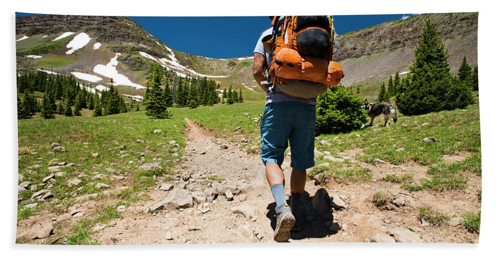 Growth Hand Towel featuring the photograph A Backpacker Hiking by Rob Hammer