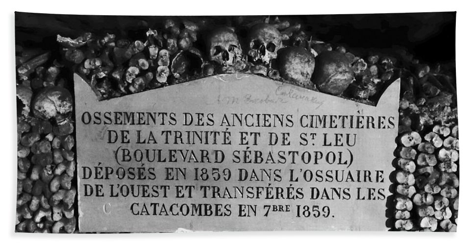 Paris Hand Towel featuring the photograph A Marker With Skulls And Bones In The Catacombs Of Paris France by Richard Rosenshein