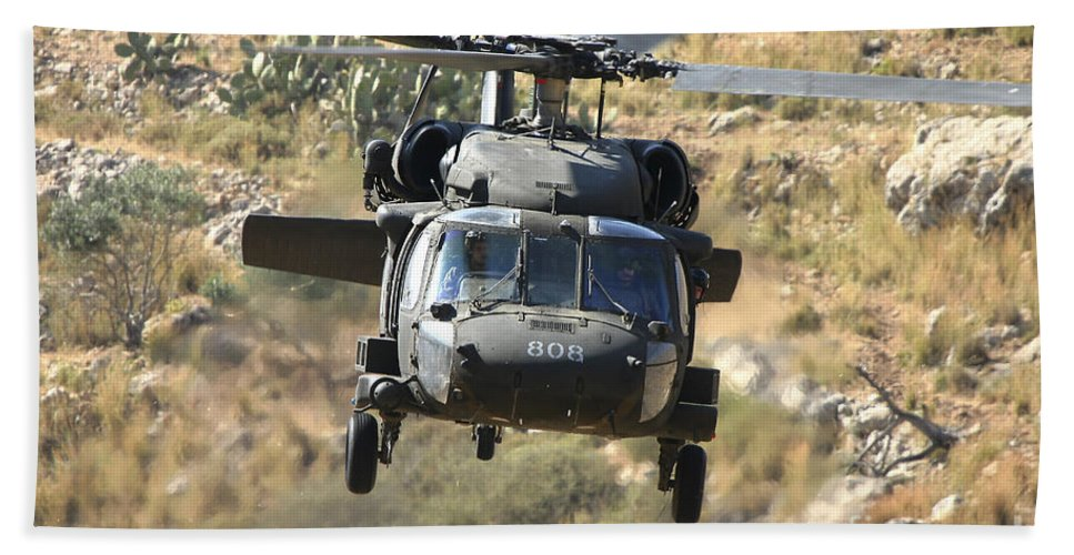 Transportation Hand Towel featuring the photograph A Uh-60l Yanshuf Helicopter by Ofer Zidon