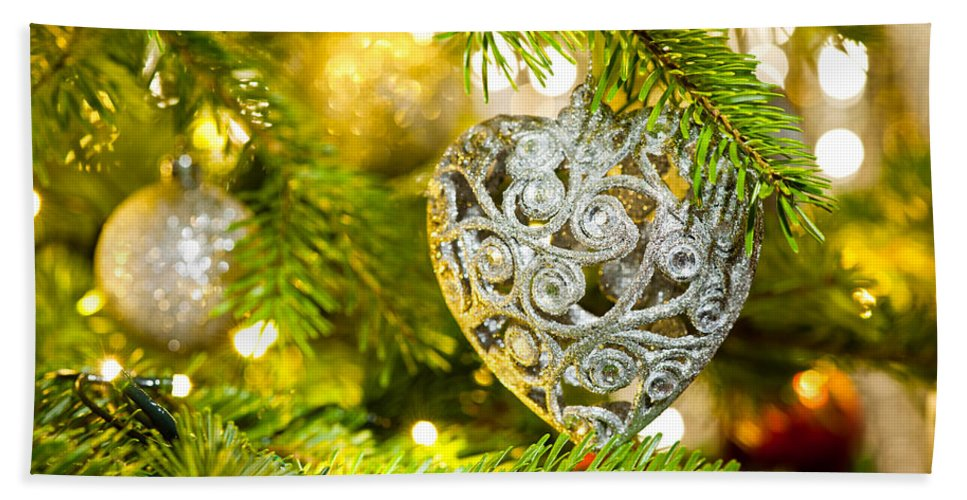 Advent Decoration Hand Towel featuring the photograph Bauble In A Christmas Tree by U Schade