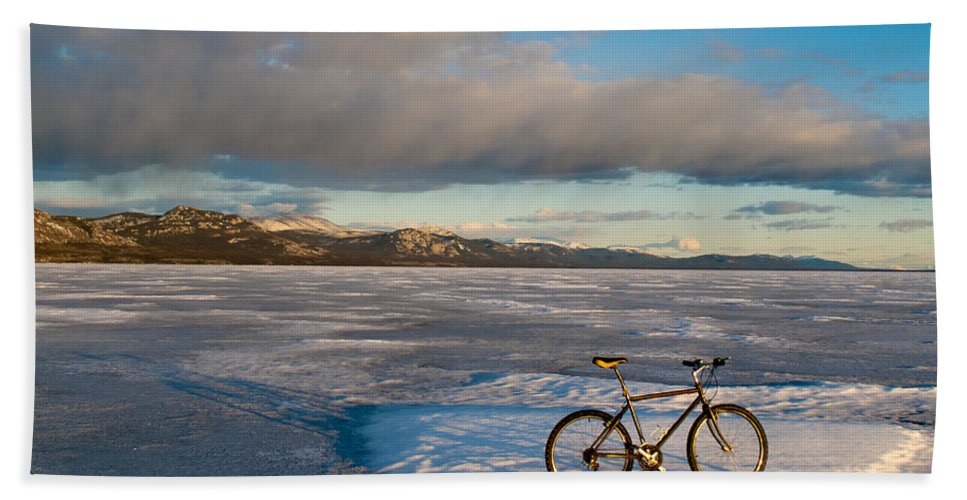 Adventure Hand Towel featuring the photograph Bike On Frozen Lake Laberge Yukon Canada by Stephan Pietzko