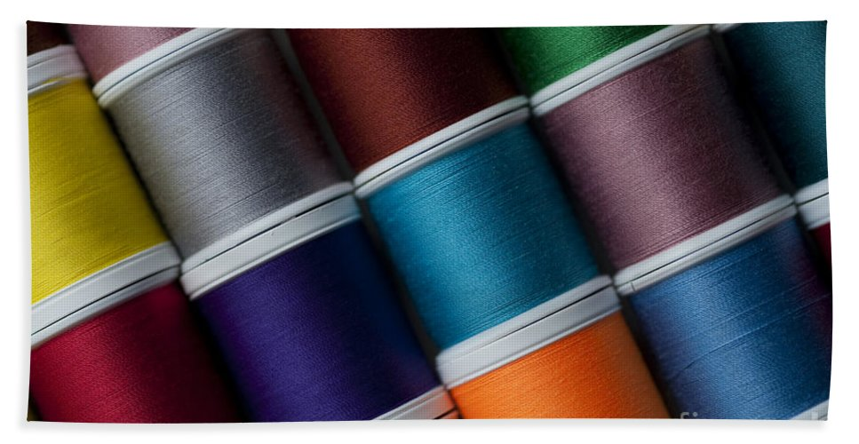 Abundance Hand Towel featuring the photograph Bright Colored Spools Of Thread by Jim Corwin