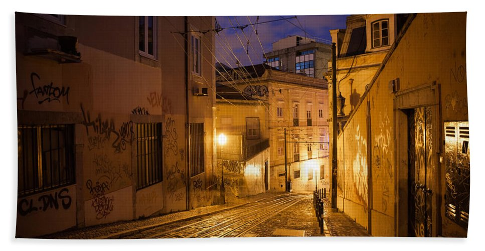 Lisbon Bath Towel featuring the photograph Calcada Da Gloria Street At Night In Lisbon by Artur Bogacki