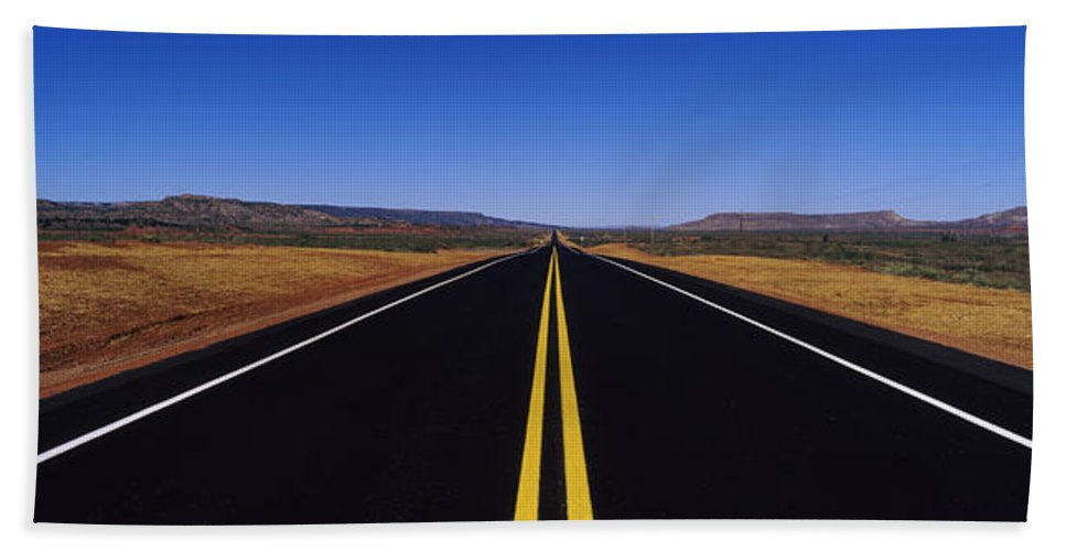 Photography Bath Towel featuring the photograph Highway Passing Through A Landscape by Panoramic Images