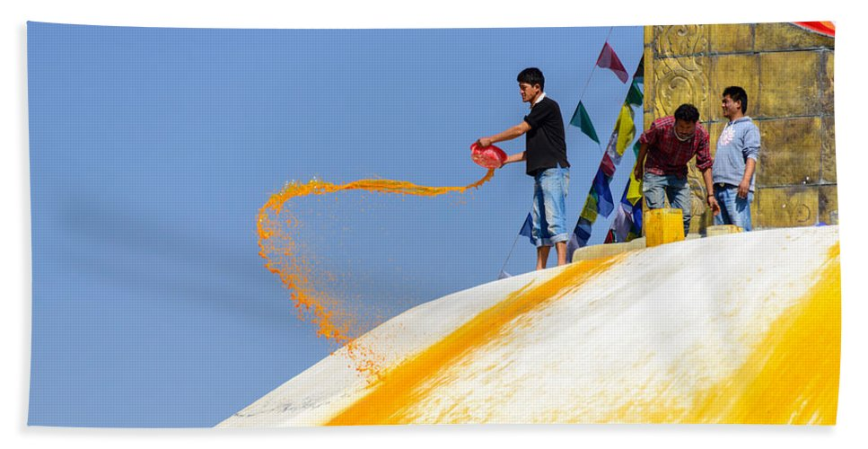 Bodnath Hand Towel featuring the photograph Man Throwing Orange Paint On Boudhanath Stupa by Dutourdumonde Photography