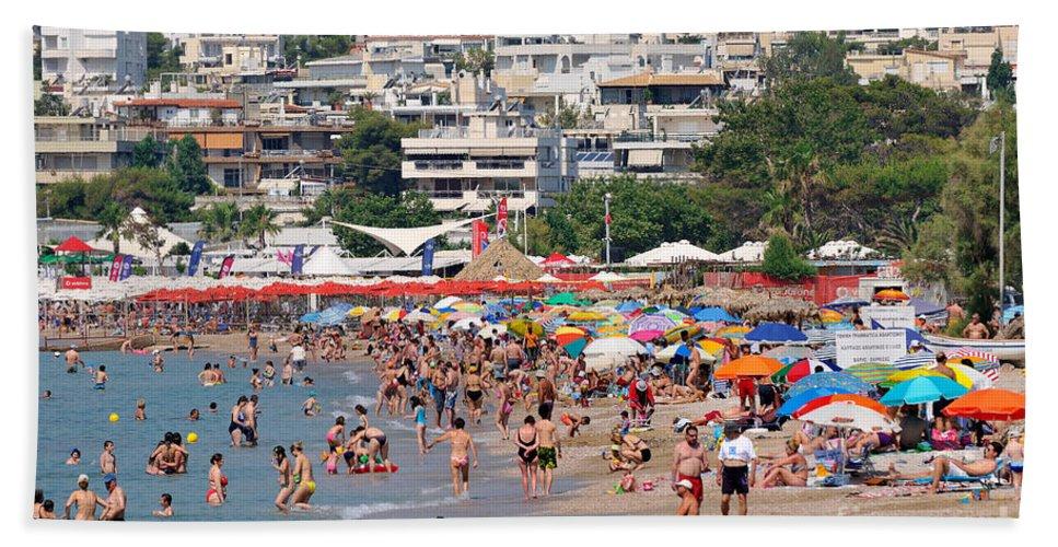 Beach; Varkiza; Sea; Sand; People; Swim; Swimming; Sunbathing; Suntanning; Tanning; Relaxing; Relaxation; Umbrellas; Parasols; Sunshades; Color; Colour; Colorful; Colourful; Crowd; Crowded; Populous; Athens; Attica; Attika; Attiki; Greece; Hellas; Greek; Hellenic; Europe; European; Holidays; Vacation; Travel; Trip; Voyage; Journey; Tourism; Touristic; Photos; Photograph; Photography Bath Sheet featuring the photograph Varkiza Beach by George Atsametakis